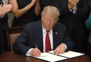 President Trump signing